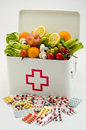 Title: Healthy food. First aid box filled with fruits and vegetables.