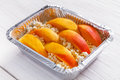 Healthy food in foil box, diet concept. Apple dessert Royalty Free Stock Photo