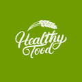 Healthy Food hand written lettering logo, label, badges or emblems for natural fresh products with ears of wheat.