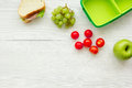 Healthy food in lunchbox for dinner at school white table background top view mockup Royalty Free Stock Photo