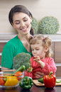 Healthy food mother and daughter prepare salads Royalty Free Stock Photo