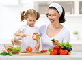 Healthy food mother and daughter prepare salads Stock Photography