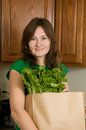 Healthy food portrait of young woman with greens for Stock Photos
