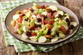 Healthy food: salad from Brussels sprouts, cranberries, almonds Royalty Free Stock Photo