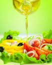 Healthy food salad and olive oil stream Royalty Free Stock Photos
