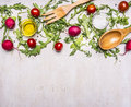 Healthy foods, cooking and vegetarian concept salad with cherry tomatoes, radishes, spices wooden spoon and fork border ,place Royalty Free Stock Photo