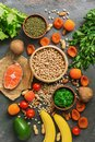 Healthy foods high in potassium. A variety of legumes, salmon, fruits, vegetables, dried apricots, seaweed chuka and nuts on a Royalty Free Stock Photo