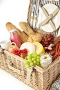 Healthy fresh fruit, bread and cheese in a hamper Royalty Free Stock Photo