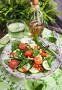 Healthy fresh spring salad with spinach tomato cucumber and pine nuts Royalty Free Stock Image