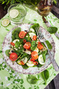 Healthy fresh spring salad with spinach tomato cucumber and pine nuts top view Royalty Free Stock Photos