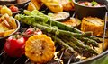 Healthy fresh summer vegetables grilling on a BBQ Royalty Free Stock Photo