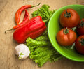 Healthy fresh vegetables ingredients for cooking in rustic setting tomatoes garlic spices chili pepper Royalty Free Stock Image