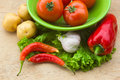Healthy fresh vegetables ingredients for cooking in rustic setting tomatoes garlic spices chili pepper Royalty Free Stock Photography