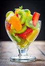 Healthy fruit salad glass with Royalty Free Stock Photo