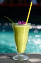 Healthy fruit shake avocado banana shake swimming pool Royalty Free Stock Images