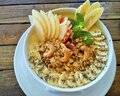 Healthy fruit smoothie bowl topped with fresh bananas, Asian pear, cashews, chia seeds, granola and mint Royalty Free Stock Photo