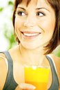 Healthy girl drinking orange juice Royalty Free Stock Photography