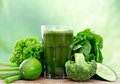 Healthy green juice vegetable on wooden table Royalty Free Stock Photo