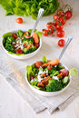 Healthy green salad with roasted carrots and broccoli Стоковые Фотографии RF