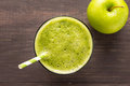 Healthy green smoothie with apple on rustic wood background Royalty Free Stock Photo