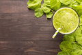 Healthy green smoothie on rustic wood background Royalty Free Stock Photo