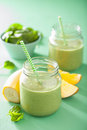 Healthy green smoothie with spinach mango banana in glass jars Royalty Free Stock Photo