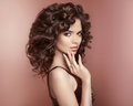Healthy hair. Beautiful young smiling woman with long curly hair Royalty Free Stock Photo