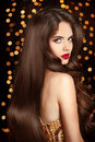 Healthy hair. Makeup. Beautiful brunette girl with long wavy hai Royalty Free Stock Photo