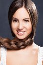 Healthy hair smiling young natural looking woman with long braid Stock Photo