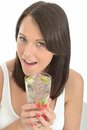 Healthy Happy Attractive Natural Young Woman Holding a Glass of Water with Ripe Lime and Ice Cubes Royalty Free Stock Photo