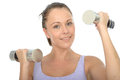 Healthy happy fit young woman training with dumb bell weights a dslr royalty free image a holding or two in both hands looking at Stock Image