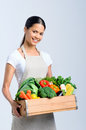 Healthy happy woman with crate of vegetables Royalty Free Stock Photo
