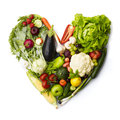 Healthy heart made by various vegetables and fruits isolated on white Royalty Free Stock Photography