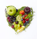 Healthy heart made by various vegetables and fruits isolated on white Royalty Free Stock Photo