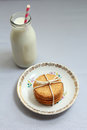Healthy home made oatmeal biscuits and a bottle of fresh milk close up Stock Images