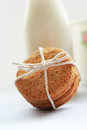 Healthy home made oatmeal biscuits and a bottle of fresh milk close up Stock Photography