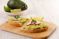 Healthy homemade appetizer two sandwiches with avocado and radish Royalty Free Stock Photo