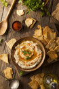 Healthy homemade creamy hummus with olive oil and pita chips Stock Photography