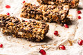 Healthy homemade muesli bar with cereals, chocolate and pomegran Royalty Free Stock Photo