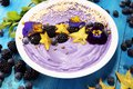 Healthy homemade raw vegan banana and berry ice cream icecream, nicecream topped with organic blackberries and blueberry