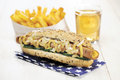 Healthy homemade vegan hot dog tofu sausage and no cheese with french fries and ice tea selective focus Royalty Free Stock Image