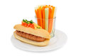 Healthy hotdog on plate isolated with celery and carrot Stock Photography