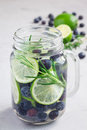 Healthy infused water with fresh blueberry, lime and rosemary, vertical Royalty Free Stock Photo