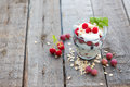Healthy layered dessert with yogurt black currant and raspberries on wooden background Stock Photo