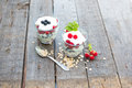 Healthy layered dessert with yogurt black currant and raspberries on wooden background Royalty Free Stock Image