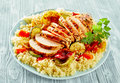 Healthy lean grilled chicken breast on couscous Royalty Free Stock Photo