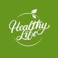 Healthy Life hand written lettering logo, label, badges or emblems with leaves.
