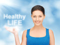 Healthy life picture of woman holding words on the palm Royalty Free Stock Photos