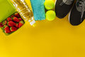 Healthy Life Sport Concept. Sneakers with Fruits, Towel and Bott