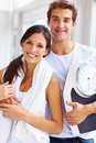 Healthy life - Young couple holding a weight scale Stock Images